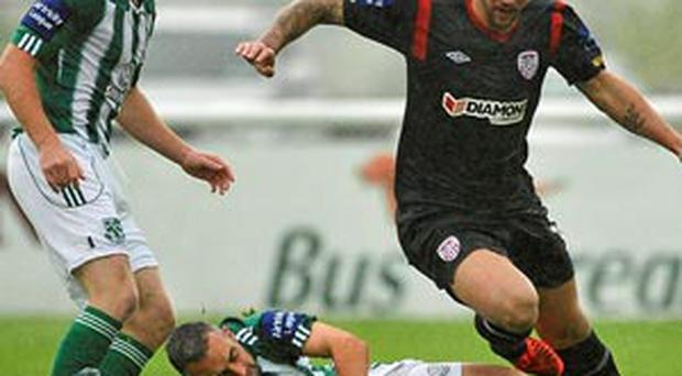 Rory Patterson, Derry City, in action against Kieran Marty Waters and Shane O'Connor, left, Bray Wanderers