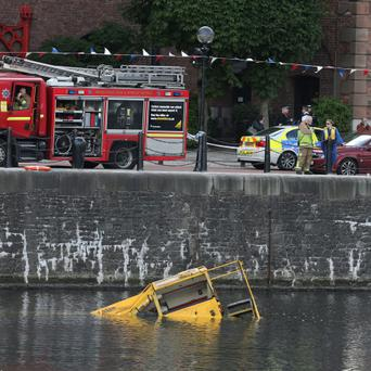 General view of emergency services after an amphibious tour bus with 30 passengers on board sank in the Albert Dock. PRESS ASSOCIATION