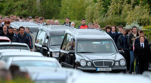 Mourners behind three hearses making their way to the church. Funeral of brothers Paul, Shane and Kenneth Bolger. Picture: Caroline Quinn