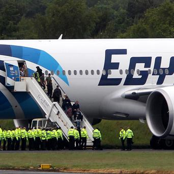 Passengers leave the Egyptair aircraft flying from Cairo to New York after it was diverted to Prestwick Airport, Ayrshire,
