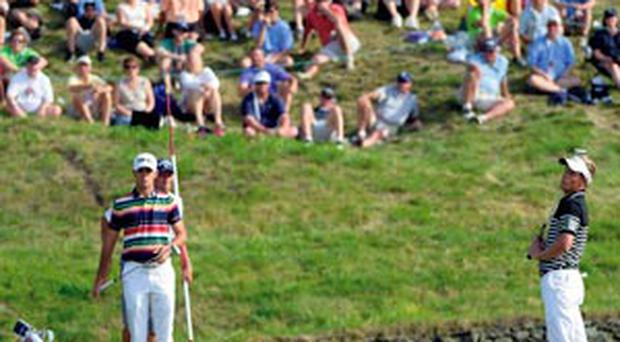 Luke Donald reacts to a missed putt during the third round of the US Open at Merion