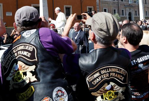 Pope Francis blesses the Harley-Davidson bikers from his Popemobile before the start of a mass outside Saint Peter's Square in Rome