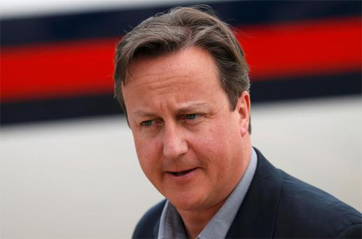 Prime Minister David Cameron arrives at Belfast International Airport
