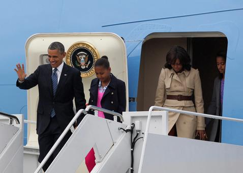 US President Barack Obama disembarks from Air Force One with his wife Michelle (second right) and daughters Sasha (second left) and Malia (right) upon arrival at Belfast International Airport, Northern Ireland, to attend the G8 summit in Enniskillen