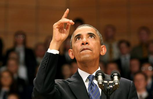 U.S. President Barack Obama speaks to guests at the Waterfront Hall in Belfast June 17
