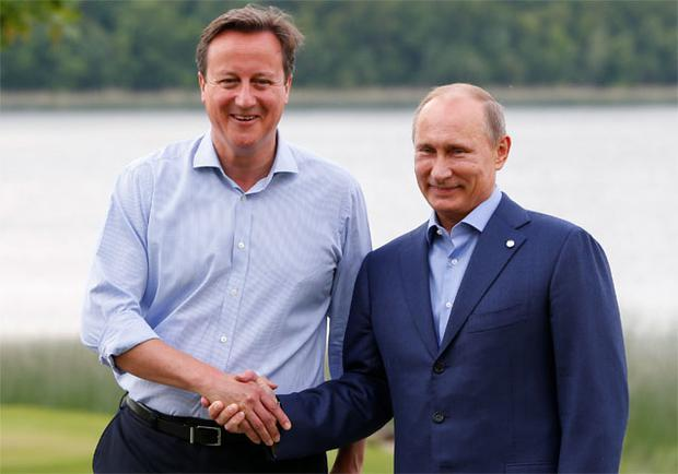 Prime Minister David Cameron (L) welcomes Russia's President Vladimir Putin to the Lough Erne golf resort where the G8 summit is taking place