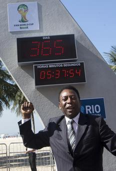 Brazilian football icon Pele cheers during the unveiling of the Hublot Countdown Clock designed by the late architect Oscar Niemeyer, at the Copacabana beach in Rio de Janeiro, last week