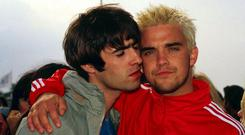Liam Gallagher and Robbie Williams at Glastonbuty in 1995.