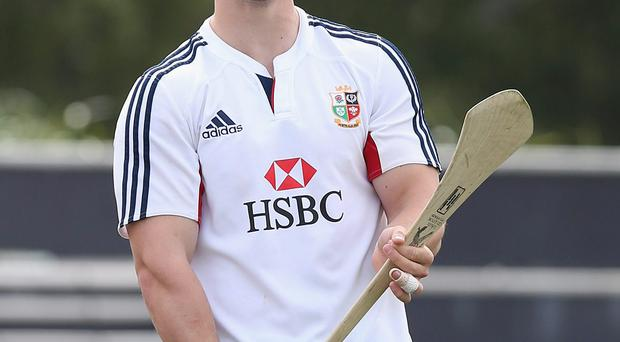 George North enjoys his hurling lesson