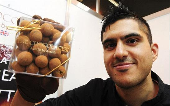 Chocoholic and maths grad-turned-entrepreneur Aneesh Popat with a box of his chocolates.