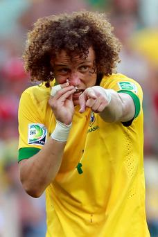 David Luiz of Brazil tends to his injured nose