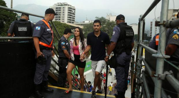 Police officers stand guard as people arrive before a Confederations Cup soccer match at the Maracana stadium in Rio de Janeiro June 20, 2013. Reuters