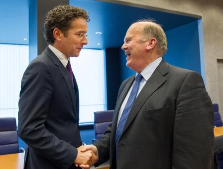 Eurogroup chairman Jeroen Dijsselbloem talking to Finance Minister Michael Noonan during the eurozone finance ministers meeting in Luxembourg yesterday