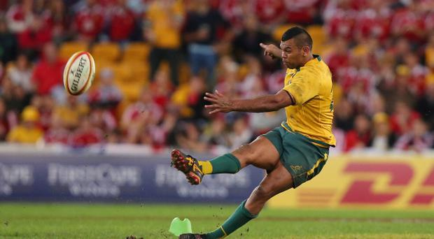 Kurtley Beale of the Wallabies slips over while kicking for goal during the First Test match between the Australian Wallabies and the British & Irish Lions at Suncorp Stadium