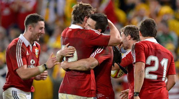 Jonathon Sexton and Jonathan Davies of the Lions celebrate victory after the First Test