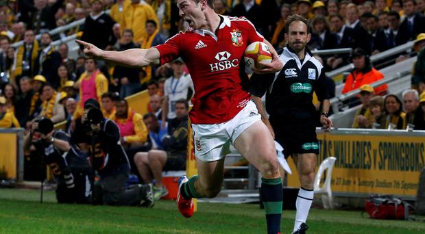 British and Irish Lions' George North gestures on his way to scoring his incredible try