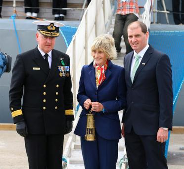 Former Ambassador Jean Kennedy Smith with the Eternal flame with Commodore Mark Mellettt flag officer naval services and Paul Kehoe TD.