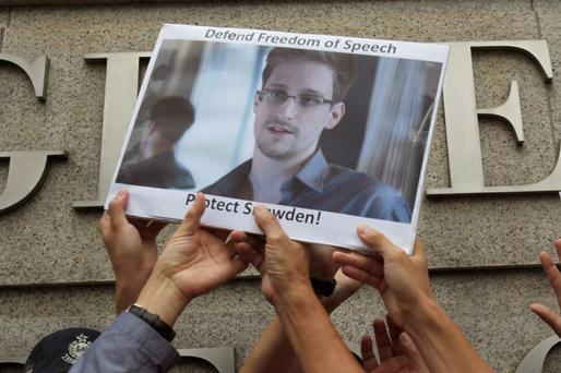 Protesters in support of Edward Snowden, a contractor at the National Security Agency