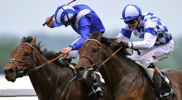 James Doyle on his mount Al Kazeem (R) wins the Prince of Wales's Stakes ahead of Paul Hanagan riding Mukhadram during the second day of Royal Ascot