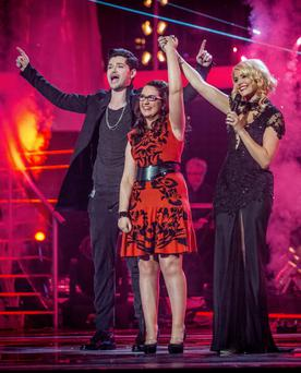 Andrea Begley from County Tyrone in Northern Ireland, with Danny O'Donoghue and Holly Willoughby, after she was crowned the winner of this year's BBC show The Voice.