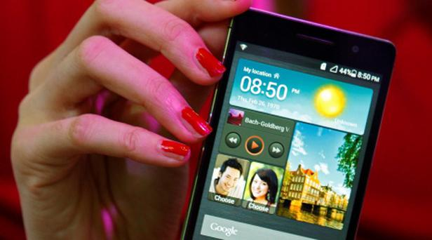 A model presents the Huawei Ascend P6 Android-based smartphone. Reuters