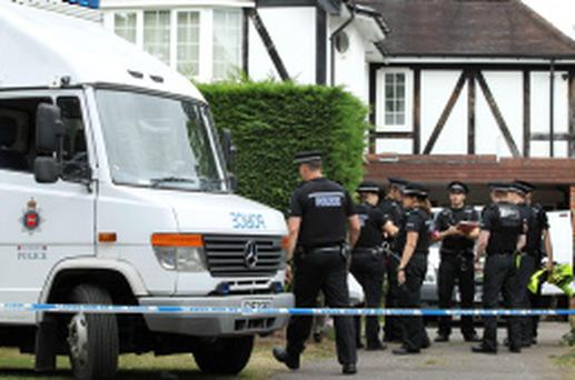 Police Officers stand outside the home of Saad al-Hilli in Claygate, south of London
