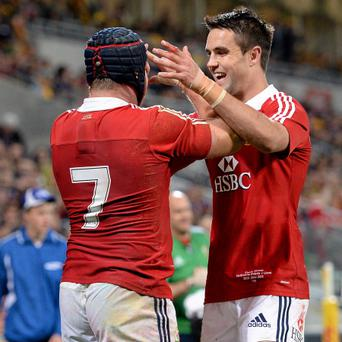 Sean O'Brien, British & Irish Lions, celebrates after scoring his side's third try with team-mate Conor Murray, right.