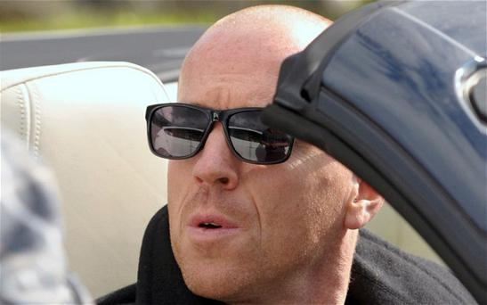 Damian Lewis sports a new bald hair style on the Isle of Mull/