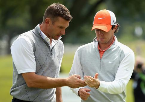 Rory McIlroy and Andriy Shevchenko exchange numbers