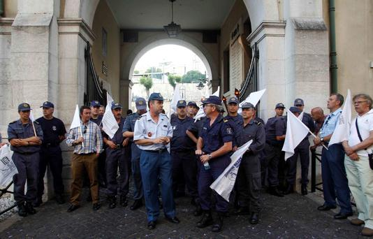 Workers demonstrate at a picket line in a firefighters' headquarters in Lisbon yesterday