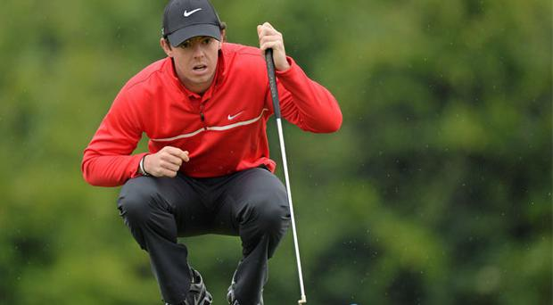 Rory McIlroy lines up a putt on the 9th green