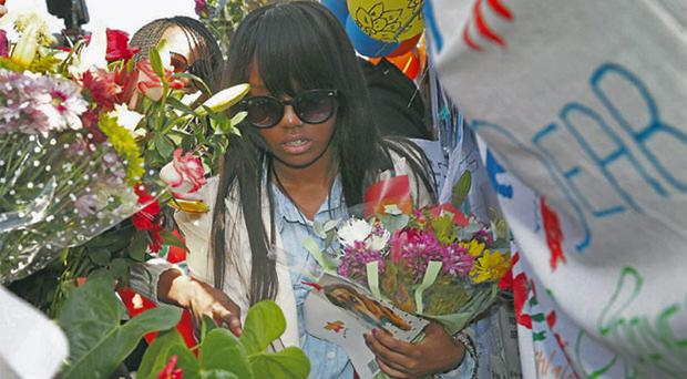 Nelson Mandela's grandchildren and great-grandchildren collected bunches of flowers left by well-wishers