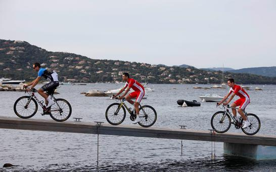 Cofidis team riders arrive for the opening ceremony of the centenary Tour de France cycling race in Porto-Vecchio