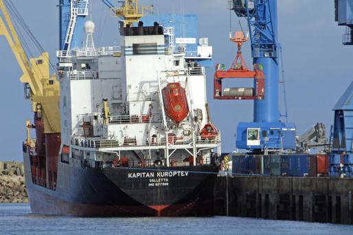 Uranium containers being loaded on to a cargo ship - the UN has warned that uranium and radioactive material have been going missing.