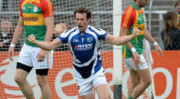 Padraig McMahon, Laois, celebrates after scoring his side's first goal.