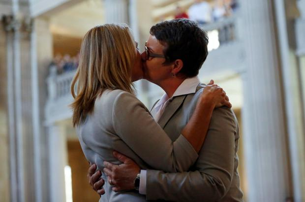 Sandy Stier and Kris Perry kiss after being married in San Francisco's City Hall