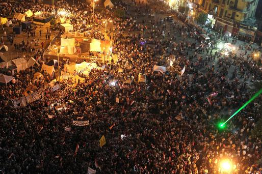 Protesters gather as they chant anti-President Mohamed Mursi slogans during a protest in Tahrir square in Cairo last night
