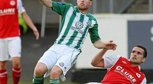 Dean Zambra, Bray Wanderers, in action against Christy Fagan, St. Patrick's Athletic.