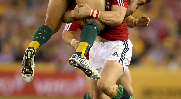 British and Irish Lions' George North carries Israel Folau and drives forward