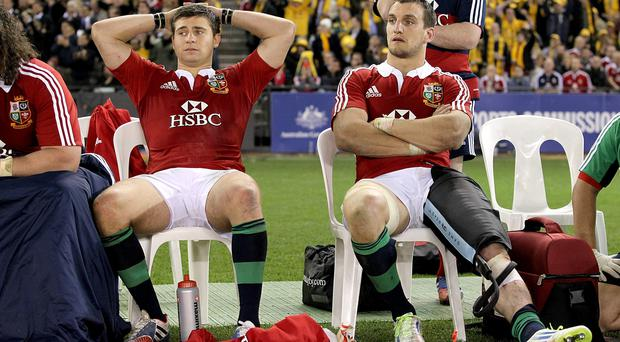 British and Irish Lions' Sam Warburton (right) sits with an injured leg alongside team-mate Ben Youngs