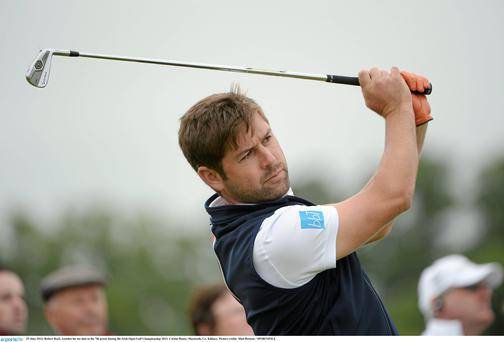 Robert Rock, watches his tee shot to the 7th green during the Irish Open today