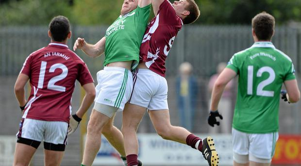 Marty McGrath in action against John Heslin