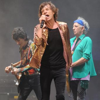 Mick Jagger (centre), Keith Richards (right) and Ronnie Wood (left) from the Rolling Stones perform on the Pyramid Stage