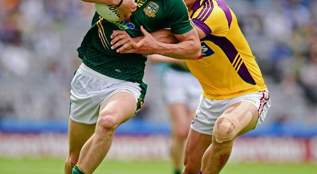 Stephen Bray, Meath, is tackled by Wexford's Lee Chin