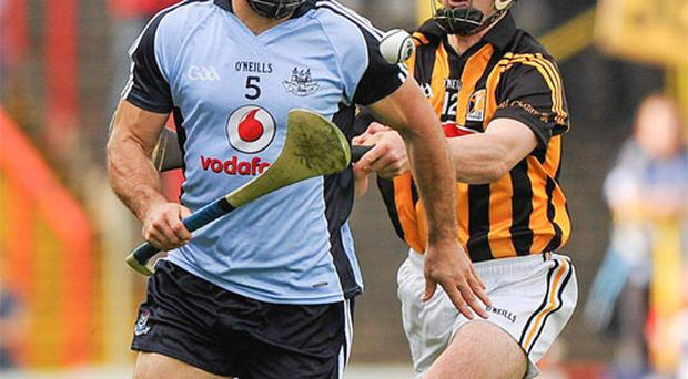 Dublin's Stephen Hiney is one step ahead of Eoin Larkin during his team's victory over Kilkenny in Portlaoise