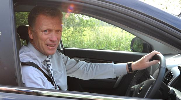 New Manchester United manager David Moyes arrives at the team training ground at Carrington today