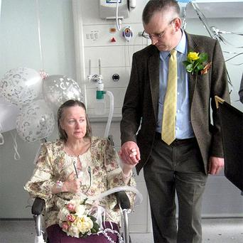 Mike Rowland getting married to his fiancee Lynda in a hospital ward