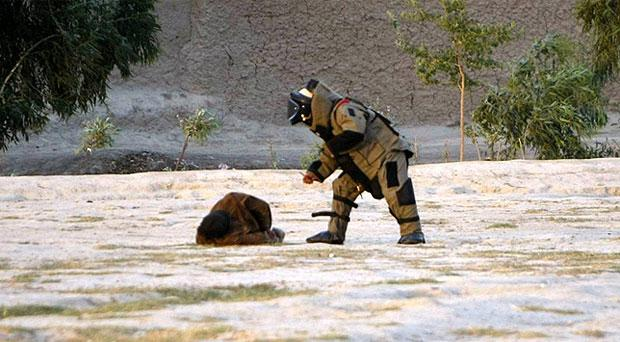 The Afghan bomb disposal officer moves in to defuse the explosives