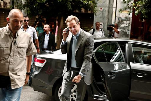 International Monetary Fund's (IMF) Deputy Director and Mission Chief to Greece Poul Thomsen arrives at the Finance ministry in Athens yesterday for talks
