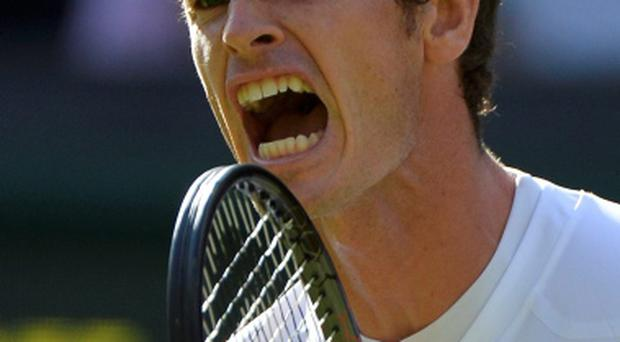 Andy Murray reacts to winning the second set tie-break in his men's singles tennis match against Mikhail Youzhny of Russia at the Wimbledon Tennis Championships